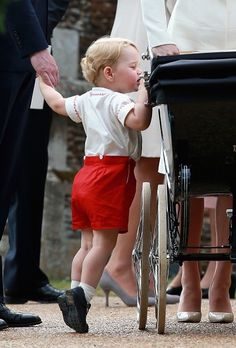 Prince George peeking at his baby sister.