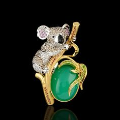 18 karat yellow and white gold, chrysoprase, diamonds, champagne diamonds, cognac diamonds, black diamonds, pink sapphires, demantoid garnet