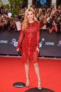 Bella Thorne at the 2015 Much Music Video Awards in an intricate red embroidered zip-front dress with her red Rauwolf clutch and Stuart Weitzman sandals.