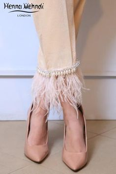 Beige velvet trousers, boot cut trousers or cigarette trousers with pearl and diamante embroidery and feather embellishment.