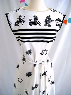 Black and white astrology dress from the 1970s, featuring astrological signs from the western zodiac. (Repinned)