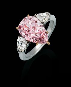Fancy Purple Pink and White Diamond Ring totaling 4.43 carats, handcrafted in platinum.