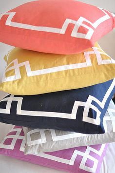 ribbon border on pillows. or use this as inspiration for our headboard instead of nailhead trim?