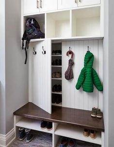 Our creative mudroom design features hidden shoe storage cabinets behind panelle. - Our creative mudroom design features hidden shoe storage cabinets behind panelled doors dressed wit - Coat And Shoe Storage, Entryway Shoe Storage, Entryway Closet, Diy Shoe Storage, Shoe Cubby, Hidden Storage, Closet Doors, Closet Mudroom, Entryway Hooks