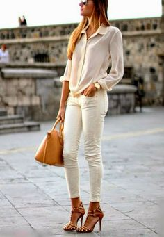 Light pink cute check shirt with white casual plan stylish jeans and brown leather hand bag and golden watch and stylish high heels sandals