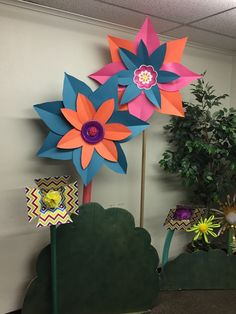 Giant paper flowers made for Journey Off the Map VBS 2015. Made using a leaf pattern then attaching to a paper plate.