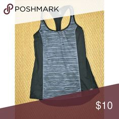 Champion Duo Dry Racerback Workout Yoga Tank Top Champion Duo Dry Racerback Workout Yoga Tank Top in Black with an Abstract Striped Center Panel & Shirt Tail Hem - No Shelf Bra - Loose Fit - Mint - Nearly New - Rarely Worn -  Visit RubyandSofia.com for even more info Size - M Chest -16 Length - 25.5 -27.5 Champion Tops Tank Tops
