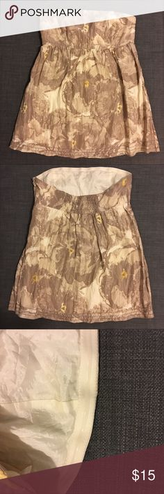 Banana Republic Silk Flower Strapless Top It is different shades of beige and the middle of the flowers are yellow.  It zips up the side and the back of the top is rouched in the middle. Measurements : Bust - 13 1/2 ( flat ) ; Length - 21 inch Banana Republic Tops Blouses