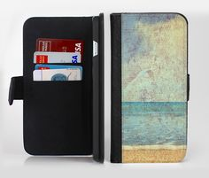 The Vintage Ocean Vintage Surface Ink-Fuzed Leather Folding Wallet Credit-Card Case for the Apple iPhone 6/6s, 6/6s Plus, 5/5s and 5c from DesignSkinz