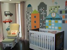 Modern, yet playful cityscape wall mural from @popdecors - such a fun accent in the nursery!