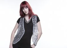 https://www.cityblis.com/7451/item/4628  Bolero Pointed Front - $403 by Walleska Ecochicc  Crocheted using recycled aluminum pull tabs and polyester based thread.  Hand crafted in Brazil.  Colors: Gray, Ramy, Black