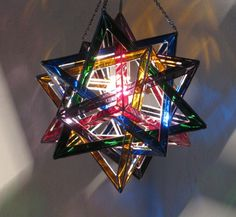 Another awesome find! Five Tetrahedra Glass Ceiling Lamp by GavilanTradingPost on Etsy,
