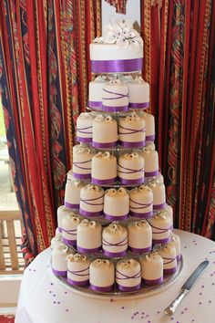 purple mini wedding cakes. Haha I like this!