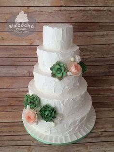 Rustic wedding cake, swiss meringue buttercream. Succulents, roses, sweetpeas.