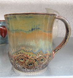 Ironstone with a stripe Arctic Blue (Angelika Prager)        Bottom....possibly  indents and slip trail dots? AMAZING with these glazes!