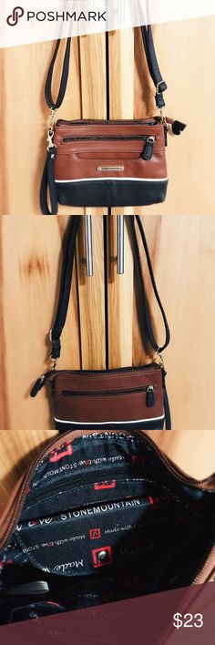 Stone Mountain Crossbody leather fashion purse Stone Mountain crossbody shoulder purse, brown, & black in color.  Stone Mountain logo inside, adjustable strap. Excellent condition, smoke free home! Happy to answer any questions & entertain offers! Stone Mountain Accessories Bags Crossbody Bags