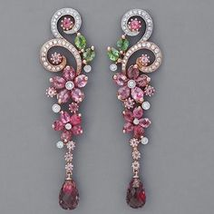 These Art Nouveau earrings with pink and green tourmalines and diamonds are daintily crafted in 18k rose gold with platinum accents.