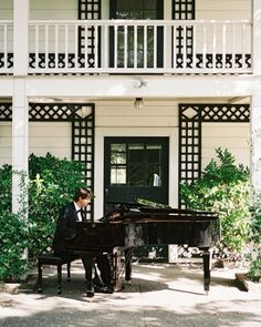 A grand piano was brought in to add a touch of city chic to this country setting