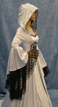 Renaissance medieval handfasting  wedding dress by camelotcostumes, $315.00  I think the black and white combo is a little harsh, but I like the idea of the shape and textures.