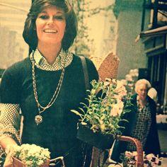 Ginette Camu flower shopping in New York.  Photo by Horst P. Horst, 1976.