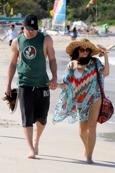 Channing Tatum and pregnant wife Jenna enjoy a stroll on the beach in St. Barts Dec. 28