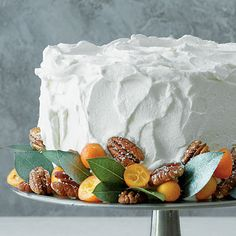 Marbled Pumpkin Praline Cake Recipe | Marbled Pumpkin Praline Cake garnished with sugared pecans, kumquats, and bay leaves. #Christmas