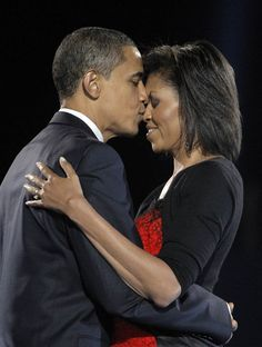 Most memorable kisses of all time:  Barack Obama shares a tender kiss with wife Michelle on the night of his historic election as the nation's first African-American president in 2008. (Photo: Jae C. Hong / AP file)