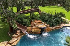 This swimming pool with slide and waterfall would look amazing in the backyard!   San Antonio Custom Pools   Keith Zars Pools