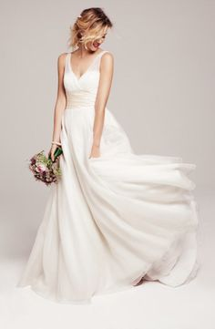A stunning ball gown style wedding dress