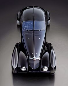 The Bugatti was unveiled in Paris in 1991 and went into production until Bugatti went out of business in 1995 (Bugatti has since been resurrected by Volkswagen). The car was available as a two-door sports car and only 31 cars were produced. Bugatti Veyron, Bugatti Cars, Bugatti Type 57, Sexy Cars, Hot Cars, Vintage Cars, Antique Cars, Carros Audi, Automobile
