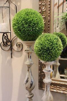 Loving the greenery balanced on wooden candle sticks    Savvy Seasons by Liz