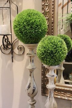 Loving the greenery balanced on wooden candle sticks    Savvy Seasons by Liz