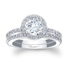 Halo Bridal Set - 7895SW - Stunning, in vogue, this white gold diamond halo engagement ring set will capture the eye of many admirers. The engagement ring features shared prong set diamonds encircling the low profile round diamond center and cascade down the dainty shank. Two diamond wedding rings grace the engagement ring on the sides for a look of sheer elegance. Also available in 18k and Platinum.