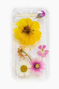 To say that we are obsessed with these gorgeous phone cases would be an understatement! We love the unexpected combo of real, dried flowers mixed with modern technology. $30 www.mooreaseal.com
