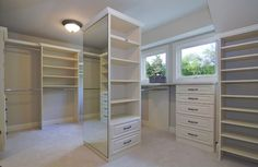 when we build new I want a massive walk in closet like this, but instead of the center mirror, I want a glass display case with my wedding gown inside...