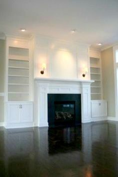 Custom fireplace and built-in bookcases by Prestige Homes, Hudson, OH
