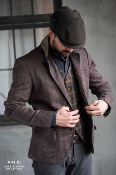 Gentleman, this is how you dress. Really well tailored, nice mix of color and pattern. A complete look that will turn heads.