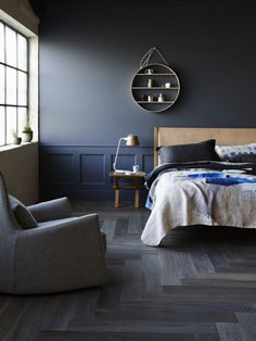 The Design Files Open House 2014 French Grey Herringbone floorboards have been used in this moody bedroom.
