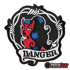 """Danger Sexy Devil Girl Patch- A sexy red devil girl embroidered around barbed wire. The word """"DANGER"""" is written underneath her in black"""