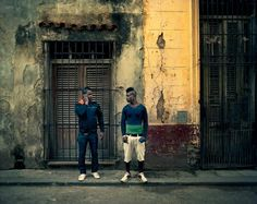 "Joakim Eskildsen for TIME Two young men wait to go out with a girl in Old Havana. ""We dress to impress her,"" they said, ""and we take pictures to our barber for him to know exactly what we want."""