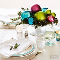 Gorgeous Christmas centerpieces don't need to take a lot of time or expensive materials—these dazzling holiday centerpieces prove it. Get inspired with beautiful yet easy Christmas table decorations that will wow your family and guests. Cheap Christmas, Modern Christmas, Simple Christmas, Christmas Holidays, Christmas Crafts, Christmas Ideas, Christmas Christmas, Holiday Ideas, Christmas Ornaments