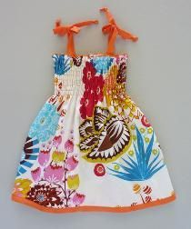 Think I can make dresses like this for my girls if I can get my sewing machine up and running again.  If not, it's time for new and better machine!