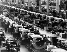 In this June 16, 1954 file photo, VW Beetles are assembled at the Volkwagen auto works plant, in Wolfsburg, West Germany. (AP Photo/Reithausen, File)