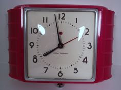 Vintage 1940s Art Deco Seth Thomas Kitchen Electric Wall Clock in RED Plastic Model E854-003. $95.00, via Etsy.