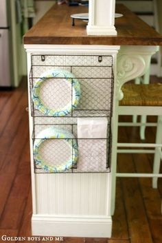 Wire basket for storage on side of kitchen island with bead board, part of Ikea . Wire basket for storage on side of kitchen island with bead board, part of Ikea Hack Kitchen Island via www. Diy Kitchen Storage, Kitchen Organization, Organization Hacks, Travel Trailer Organization, Basket Organization, Basket Storage, Organizing Ideas, Plate Storage, Cabinet Storage