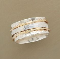 PERFECT PARTNERS RING -- Hand-hammered bands of sterling silver and 14kt gold…