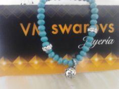 swarovs azul con llamador de ángel. $100.