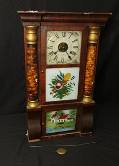 """Seth Thomas """"Brass Clocks"""" with two reverse paint on glass panels. 16.5""""x32.5""""T. Clock Collection Auction Ending 3/17/13."""
