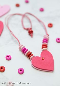 This DIY Reversible Valentine Heart Necklace makes a great gift for a classroom Valentine! A quick and easy craft that can be made in just a few minutes! Valentine Crafts For Kids, Homemade Valentines, Valentine Heart, Valentine Wreath, Valentine Ideas, Valentine Gifts, Diy Valentine's Hearts, Valentine's Day Crafts For Kids, Kids Necklace