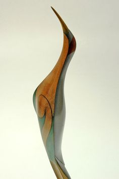 Medium: kauri. Size: 21 x 3.75 x 5.5 inches. A member of the Crane bird family, the Brolga is a tall, elegant grey bird with a straight bill longer than its head. A rare vagrant to New Zealand from Australia, the Brolga inhabits swamps and damp pastures.